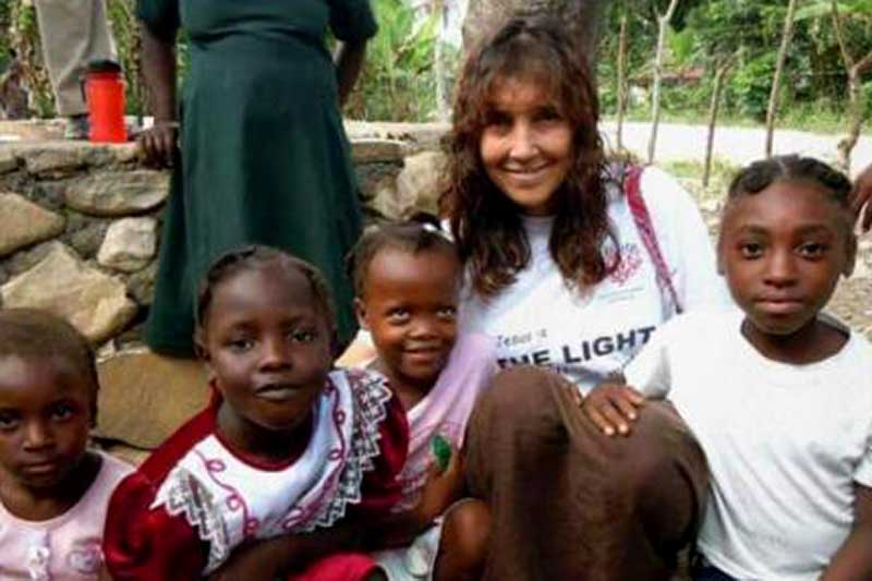 Tina Kadolph with children in Haiti