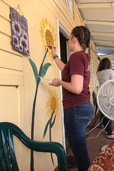 painting sunflowers on the house